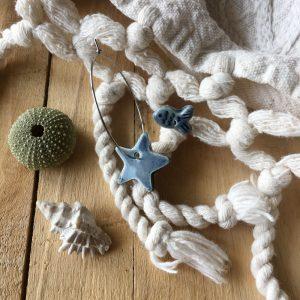 orecchini asimmetrici pesciolino e stella